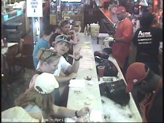 The gang and I hanging out at the Acme Oyster House in New Orleans. This picture was taken during the Jazzfest 2001 by the webcam at the end of the bar.