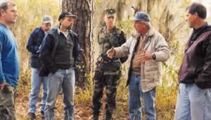 Neel describes the workings of a healthy  longleaf pine ecosystem. Photo by Richard T. Bryant. Email richard_t_bryant@mindspring.com