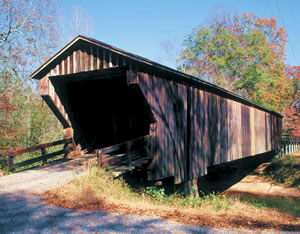 Big Red Oak Creek Covered Bridge, erected on a tributary of the Flint River in Meriwether County, was built in the 1840s by former slave Horace King. It is the oldest covered bridge in Georgia and the longest wooden bridge.  Photo by Richard T. Bryant. Email richard_t_bryant@mindspring.com